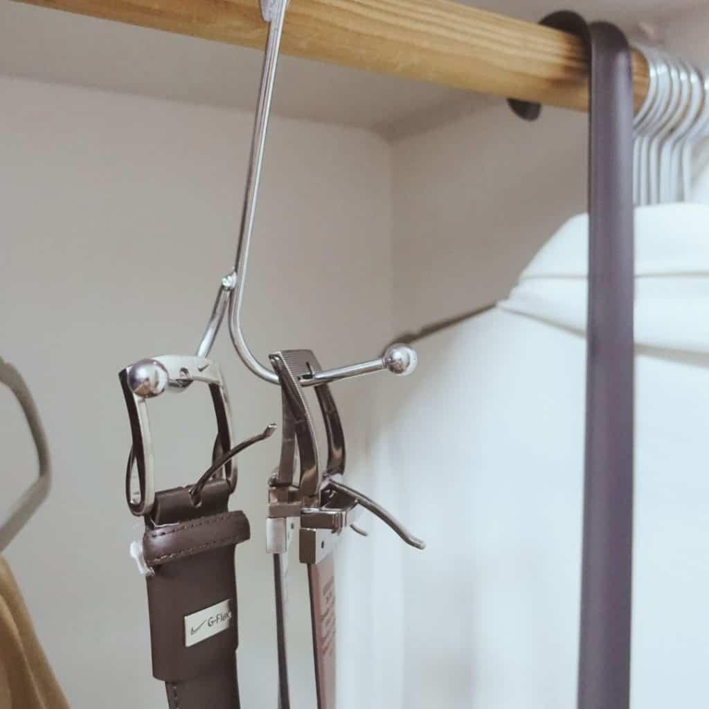 belt storage using dollar store door hook inside of closet